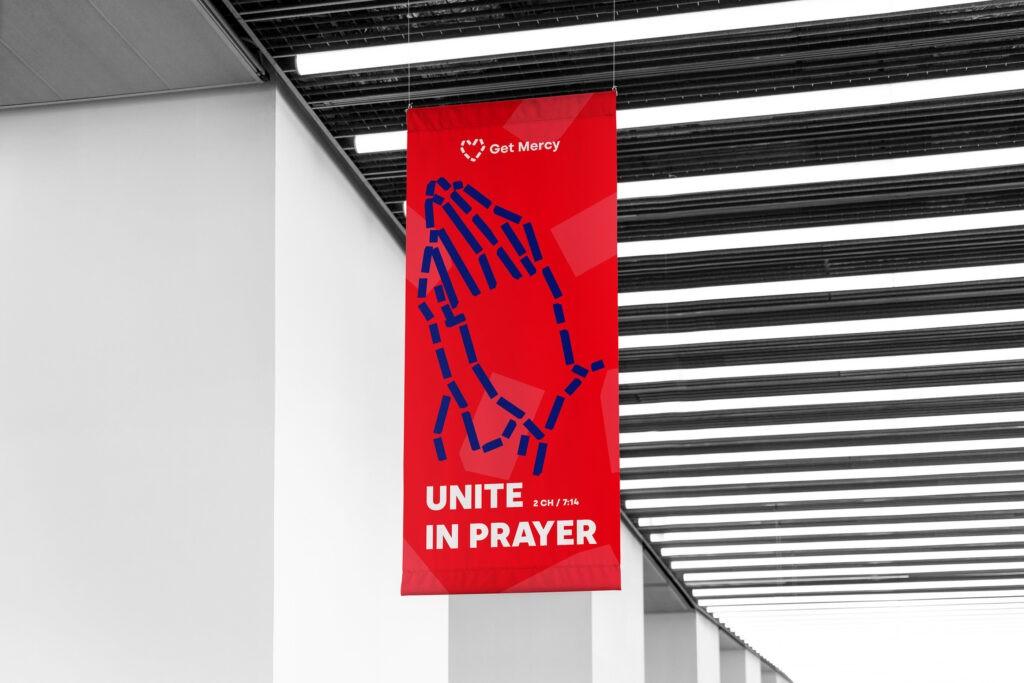 unite in prayer get mercy rollup banner
